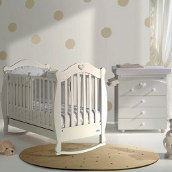 A small bedroom with a cot and baby bath Susy Baby Italia mattress free